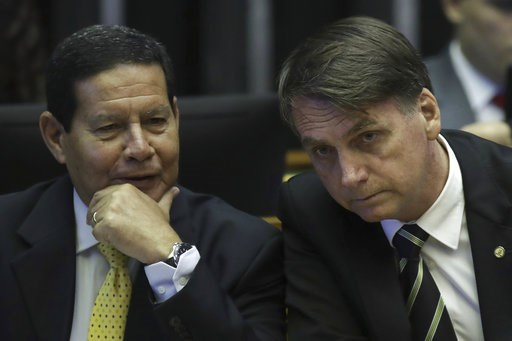 (AP Photo/Eraldo Peres, File). FILE - In this Nov. 6, 2018 file photo, Brazilian President-elect Jair Bolsonaro, right, and his Vice President Gen. Hamilton Mourao attend a ceremony marking the 30th anniversary of Brazil's constitution at Congress in B...