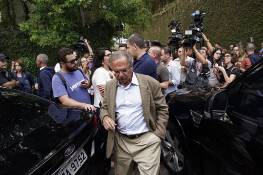 (AP Photo/Leo Correa, File). FILE - In this Oct. 30, 2018 file photo, Paulo Guedes, head economic adviser of President-elect Jair Bolsonaro, leaves after a meeting with Bolsonaro and his transition team in Rio de Janeiro, Brazil. Guedes, who holds a do...