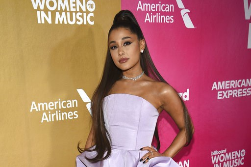 (Photo by Evan Agostini/Invision/AP). Ariana Grande attends the 13th annual Billboard Women in Music event at Pier 36 on Thursday, Dec. 6, 2018, in New York.