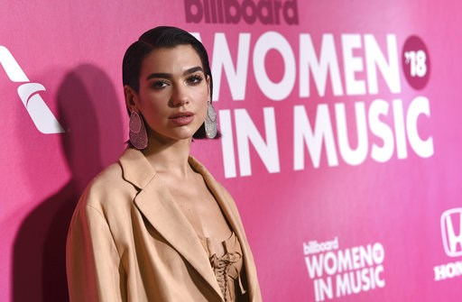 (Photo by Evan Agostini/Invision/AP). Dua Lipa attends the 13th annual Billboard Women in Music event at Pier 36 on Thursday, Dec. 6, 2018, in New York.