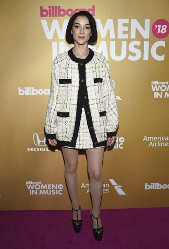 (Photo by Evan Agostini/Invision/AP). St. Vincent attends the 13th annual Billboard Women in Music event at Pier 36 on Thursday, Dec. 6, 2018, in New York.
