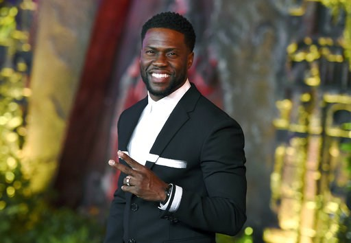 "(Photo by Jordan Strauss/Invision/AP, File). FILE - In this Dec. 11, 2017 file photo, Kevin Hart arrives at the Los Angeles premiere of ""Jumanji: Welcome to the Jungle"" in Los Angeles. Hart will host the 2019 Academy Awards, fulfilling a lifelong dream..."