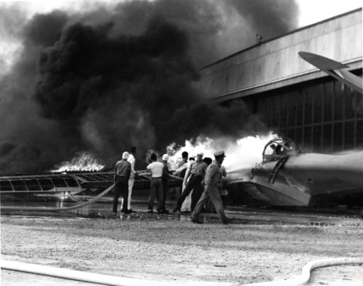 (U.S. Navy via AP, File). FILE - In this Dec. 7, 1941 file photo provided by the U.S. Navy, a patrol bomber burns at a military installation on Oahu's Kaneohe Bay during the Japanese attack on Pearl Harbor in Hawaii. Retired U.S. Navy Cmdr. Don Long wa...