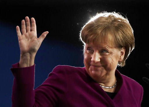 (AP Photo/Markus Schreiber, file). FILE - In this Monday, Feb. 26, 2018 file photo German Chancellor and party chairwoman Angela Merkel waves during the party convention of the Christian Democratic Union CDU in Berlin, Germany. Three high-profile conte...