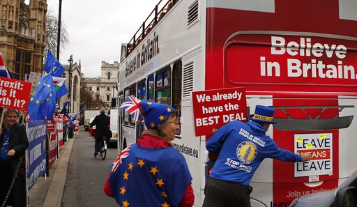 (AP Photo/Frank Augstein). Anti Brexit demonstrators put stickers on a bus during a protest outside the Houses of Parliament in London Thursday Dec. 6, 2018.  Britain's Prime Minister Theresa May's effort to win support for her Brexit agreement comes a...