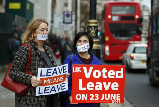 (AP Photo/Frank Augstein). Demonstrators protest for Brexit outside the Houses of Parliament in London Thursday Dec. 6, 2018.  Britain's Prime Minister Theresa May's effort to win support for her Brexit agreement comes amid reports in British newspaper...