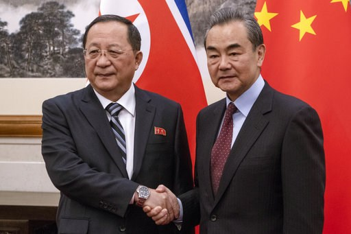 (Fred Dufour/Pool Photo via AP). North Korean Foreign Minister Ri Yong Ho, left meets China's Foreign Minister Wang Yi at the Diaoyutai State Guesthouse in Beijing  Friday, Dec. 7, 2018.