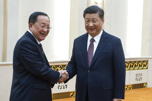 (Fred Dufour/Pool Photo via AP). China's President Xi Jinping, right, shakes hands with North Korean Foreign Minister Ri Yong Ho at the Great Hall of the People in Beijing, Friday, Dec. 7, 2018. The foreign ministers of China and North Korea held talks...