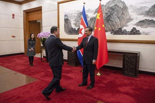 (Fred Dufour/Pool Photo via AP). North Korean Foreign Minister Ri Yong Ho, center, meets China's Foreign Minister Wang Yi at the Diaoyutai State Guesthouse in Beijing  Friday, Dec. 7, 2018.
