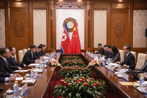 (Fred Dufour/Pool Photo via AP). North Korean Foreign Minister Ri Yong Ho, second left, meets China's Foreign Minister Wang Yi, right, during a meeting at the Diaoyutai State Guesthouse in Beijing  Friday, Dec. 7, 2018.