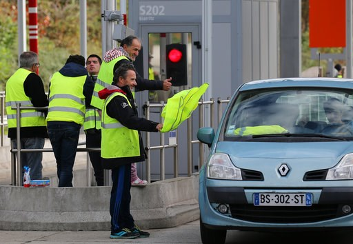 (AP Photo/Bob Edme). A demonstrator holds a yellow jacket as he protests at the toll gates on motorway at Biarritz southwestern France, Thursday, Dec.6, 2018. Paris police and store owners are bracing for new violence at protests Saturday, despite Pres...