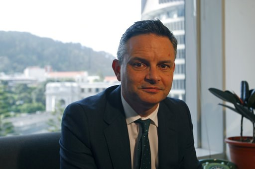 (AP Photo/Nick Perry). In this Dec. 4, 2018, photo, New Zealand's Climate Change Minister James Shaw poses in Wellington, New Zealand. New Zealand has set itself apart from neighboring Australia by declaring climate change a top priority. But despite s...