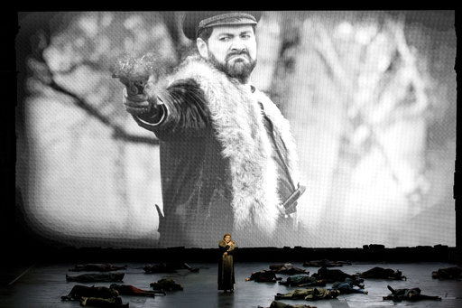 (Brescia/Amisano/Teatro alla Scala via AP). This undated photo made available by La Scala opera theater on Dec. 5, 2018 shows Spanish soprano Saioa Hernandez performing on stage in front of a screen showing Russian bass Ildar Abdrazakov during a rehear...