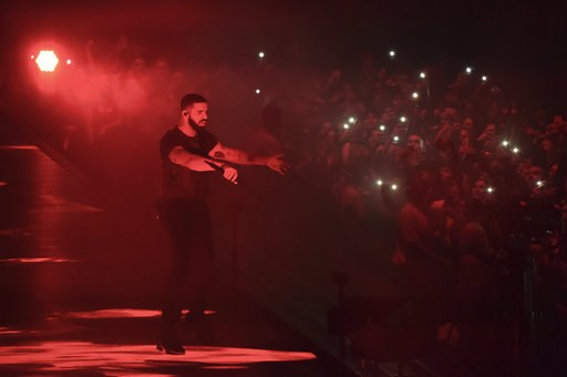 (Photo by Richard Shotwell/Invision/AP, File). FILE- In this Oct. 12, 2018, file photo Drake performs at the Staples Center in Los Angeles. A list of nominees in the top categories at the 2019 Grammys, including Kendrick Lamar, who is the leader with e...