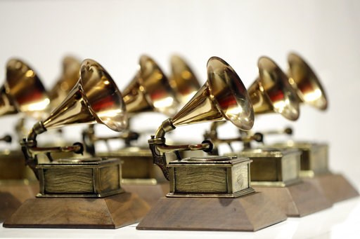 (AP Photo/Julio Cortez, File). FILE - In this Oct. 10, 2017, file photo, various Grammy Awards are displayed at the Grammy Museum Experience at Prudential Center in Newark, N.J. Nominations for the 61st annual Grammy Awards will be announced Friday mor...