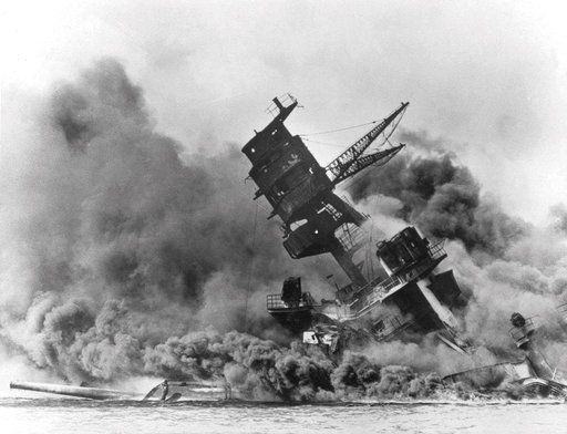 (AP Photo, File). In this Dec. 7, 1941 file photo, smoke rises from the battleship USS Arizona as it sinks during the Japanese attack on Pearl Harbor, Hawaii. About 20 survivors are gathering on Friday, Dec. 7, 2018 at Pearl Harbor to remember thousand...
