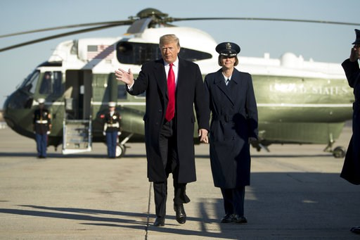 (AP Photo/Andrew Harnik). President Donald Trump walks to board Air Force One at Andrews Air Force Base, Md., Friday, Dec. 7, 2018, to travel to Kansas City, Mo., to speak at the 2018 Project Safe Neighborhoods National Conference.