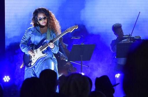 (Photo by Richard Shotwell/Invision/AP, File). FILE - In this June 24, 2018 file photo, H.E.R. performs at the BET Awards at the Microsoft Theater in Los Angeles. A list of nominees in the top categories at the 2019 Grammys, including Kendrick Lamar, w...