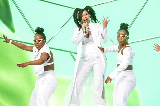 (Photo by Amy Harris/Invision/AP, File). FILE - In this April 15, 2018 file photo, Cardi B performs at the Coachella Music & Arts Festival at the Empire Polo Club in Indio, Calif. A list of nominees in the top categories at the 2019 Grammys, includ...