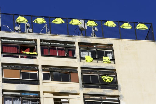 (AP Photo/Claude Paris). Yellow vests hang on the rooftop of an apartment building Friday, Dec. 7, 2018 in Marseille, southern France. Across the country, France is mobilizing some 89,000 police, up from 65,000 last weekend when more than 130 people we...