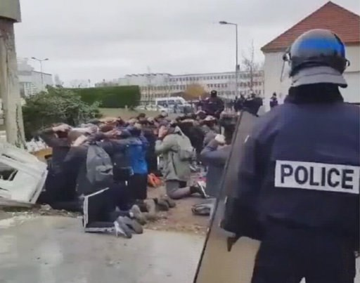(UGC video via AP). In this image taken from amateur video, showing police as they detain a large number of students Thursday Dec. 6, 2018, at Mantes-la-Jolie, France.  Images have been shared widely on social media, showing a mass of students being de...