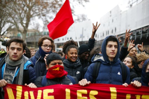 (AP Photo/Thibault Camus). School children demonstrate in Paris, Friday Dec.7, 2018. Footage showing the brutal arrest of high school students protesting outside Paris is causing a stir ahead of further anti-government protests this weekend.
