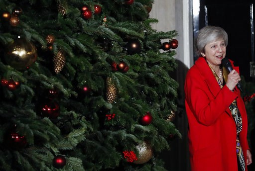 (AP Photo/Frank Augstein). Britain's Prime Minister Theresa May attends the ceremony to light up a Christmas tree at 10 Downing Street in London, Thursday, Dec. 6, 2018.