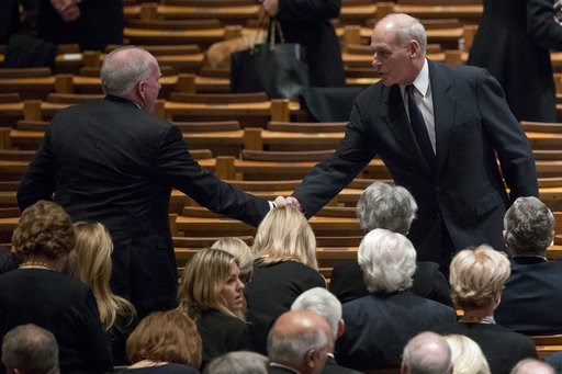 (AP Photo/Andrew Harnik, Pool). Former CIA Director John Brennan, left, shakes hands with President Donald Trump's Chief of Staff John Kelly, right, before a State Funeral for former President George H.W. Bush at the National Cathedral, Wednesday, Dec....