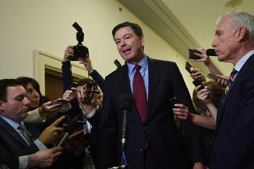(AP Photo/Susan Walsh). Former FBI Director James Comey, center, standing with his attornery David Kelley, right, speaks to reporters on Capitol Hill in Washington, Friday, Dec. 7, 2018, following his appearance before a closed-door hearing with the Ho...