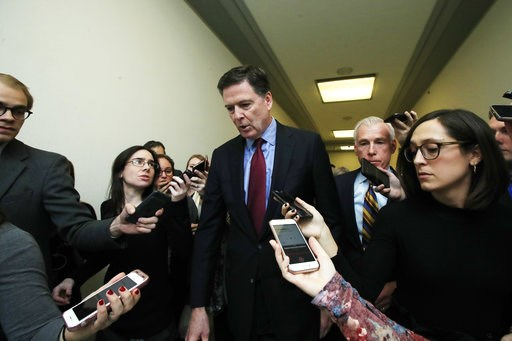 (AP Photo/Manuel Balce Ceneta). Former FBI Director James Comey speaks to reporters after testifying under subpoena behind closed doors before the House Judiciary and Oversight Committee on Capitol Hill in Washington, Friday, Dec. 7, 2018.