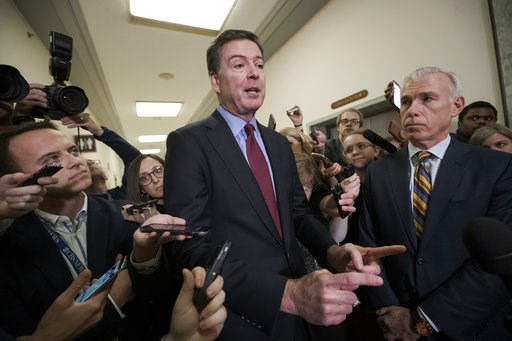 (AP Photo/J. Scott Applewhite). Former FBI Director James Comey, with his attorney, David Kelley, right, speaks to reporters after a day of testimony compelled by the GOP-led House Judiciary and Oversight committees, on Capitol Hill in Washington, Frid...