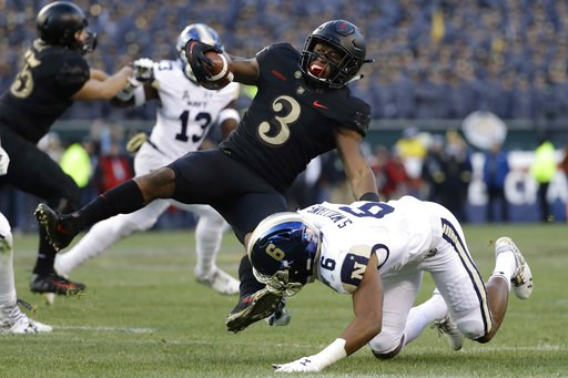 (AP Photo/Matt Slocum). Army's Jordan Asberry, left, is tackled by Navy's Sean Williams during the first half of an NCAA college football game, Saturday, Dec. 8, 2018, in Philadelphia.