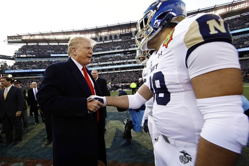 (AP Photo/Matt Rourke). President Donald Trump meets with Navy player Anthony Gargiulo ahead of an NCAA college football game between Army and Navy, Saturday, Dec. 8, 2018, in Philadelphia.