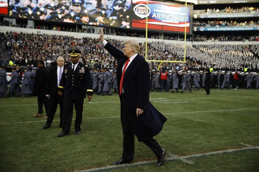 (AP Photo/Matt Rourke). President Donald Trump waves to attendees ahead of an NCAA college football between Army and Navy, Saturday, Dec. 8, 2018, in Philadelphia.