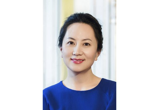 (Huawei via AP). In this undated photo released by Huawei, Huawei's chief financial officer Meng Wanzhou is seen in a portrait photo. China on Thursday, Dec. 6, 2018, demanded Canada release the Huawei Technologies executive who was arrested in a case ...