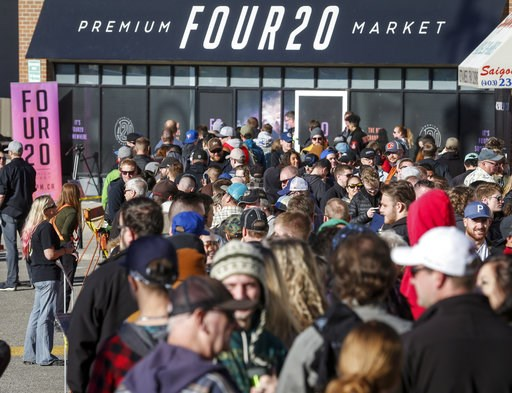 (Jeff McIntosh/The Canadian Press via AP, File). FILE - In this Oct. 17, 2018, file photo, people line-up to purchase legal cannabis in Calgary, Alberta. California became America's largest legal marketplace, while Canada became the second and largest ...