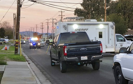 (Deke Farrow/The Modesto Bee via AP). Police investigate the scene of a shooting that took the life of Newman Police Officer Ronil Singh, 33, on Wednesday, Dec. 26, 2018, in Newman, Calif. Authorities were searching Wednesday for a gunman who shot and ...