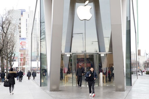 (AP Photo/Mary Altaffer). Customers leave the Apple store in the Brooklyn borough of New York, Thursday, Jan. 3, 2019. Apple's shock warning that its Chinese sales are weakening ratcheted up concerns about the world's second largest economy and weighed...