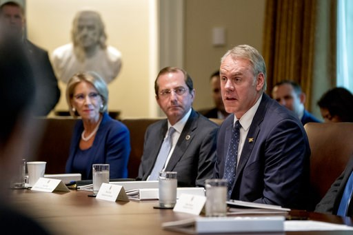 (AP Photo/Andrew Harnik, File). FILE - In this Thursday, Aug. 16, 2018 file photo, Interior Secretary Ryan Zinke, right, accompanied by Education Secretary Betsy DeVos, left, and Health and Human Services Secretary Alex Azar, center, speaks during a ca...