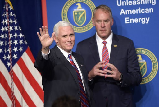 (AP Photo/Susan Walsh, File). FILE - In this June 29, 2017, file photo, Vice President Mike Pence, left, waves as he is introduced to speak at the Department of Energy in Washington, as Interior Secretary Ryan Zinke watches. As former U.S. Interior Sec...