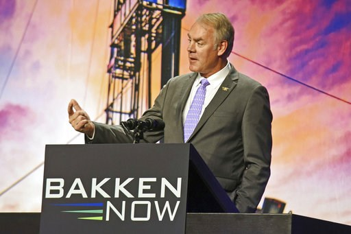 (Tom Stromme/The Bismarck Tribune via AP, File). FILE - In this May 23, 2018, file photo, then U.S. Interior Secretary Ryan Zinke speaks at the Williston Basin Petroleum Conference in the Bismarck Event Center in Bismarck, N.D. As former U.S. Interior ...