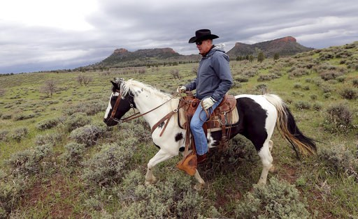 (Scott G Winterton/The Deseret News via AP, File). FILE - In this May 9, 2017, file photo, then Interior Secretary Ryan Zinke rides a horse in the new Bears Ears National Monument near Blanding, Utah. As former U.S. Interior Secretary Zinke exits Washi...