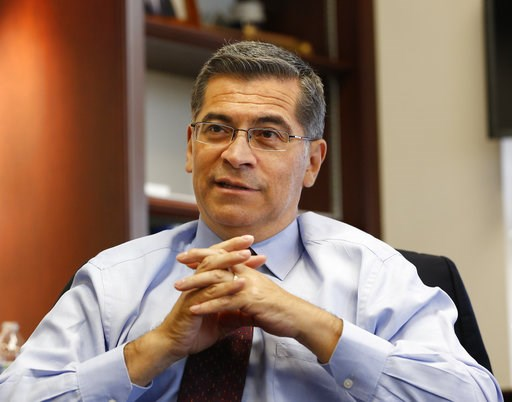 (AP Photo/Rich Pedroncelli). In this Oct. 10, 2018 photo, California Attorney General Xavier Becerra discusses various issues during an interview with The Associated Press, in Sacramento, Calif. As the state's first Latino attorney general, Becerra is ...