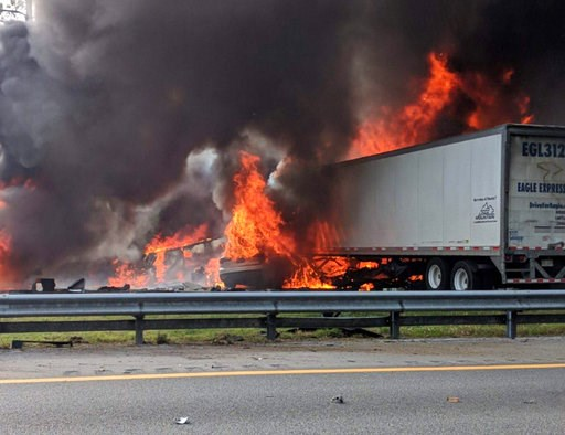 (WGFL-Gainesville via AP). Flames engulf vehicles after a fiery crash along Interstate 75, Thursday, Jan. 3, 2019, about a mile south of Alachua, near Gainesville, Fla. Highway officials say at least six people have died after a crash and diesel fuel s...