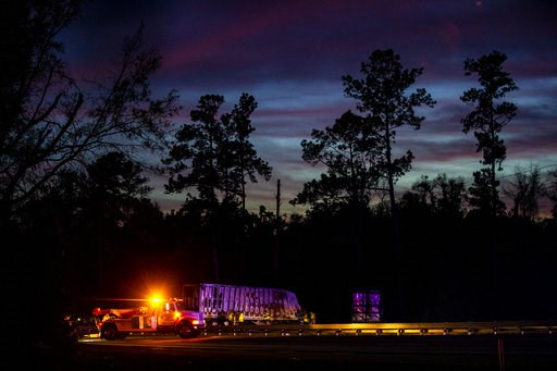 (Lauren Bacho/The Gainesville Sun via AP). CORRECTS SOURCE TO THE GAINESVILLE SUN The sun sets over burned semi-trucks and vehicle debris after a wreck with multiple fatalities on Interstate 75, south of Alachua, near Gainesville, Fa., Thursday, Jan. 3...