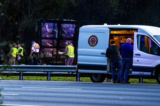 (Lauren Bacho/The Gainesville Sun via AP). CORRECTS SOURCE TO THE GAINESVILLE SUN Police survey the scene after a wreck with multiple fatalities on Interstate 75, south of Alachua, near Gainesville, Fa., Thursday, Jan. 3, 2019. Two big rigs and two pas...