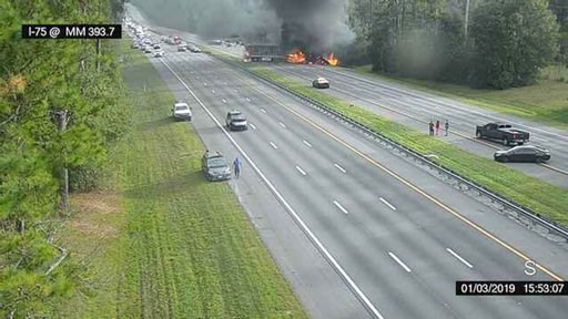 (Alachua County Fire Rescue/Florida 511 via AP). This image taken from a Florida 511 traffic camera and provided by the Alachua County Fire Rescue, shows a fiery crash along Interstate 75, Thursday, Jan. 3, 2019, about a mile south of Alachua, near Gai...