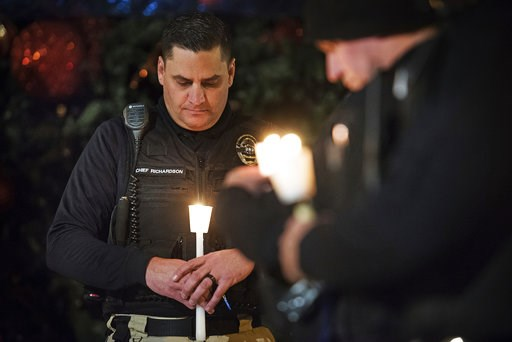 (Andy Alfaro/The Modesto Bee via AP,File). FILE - In this Friday, Dec. 28, 2018 file photo, Newman Police Chief Randy Richardson and hundreds of others attend a vigil in memory of police Cpl. Ronil Singh in Newman, Calif. The Northern California police...