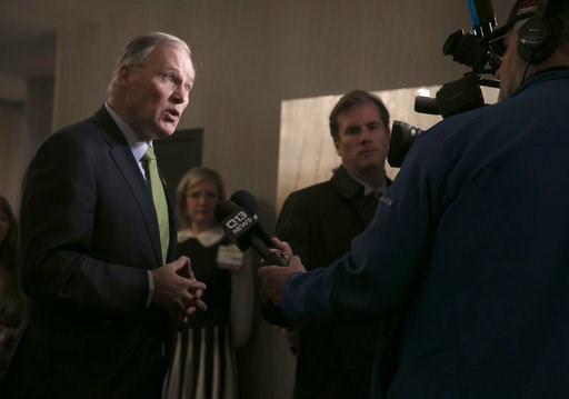 (Erika Schultz/The Seattle Times via AP). Washington Gov. Jay Inslee speaks with the media at the annual Washington Cannabis Summit, Friday, Jan. 4, 2019, in SeaTac, Wash. Seven years after the state legalized the adult use of marijuana, Inslee says he...