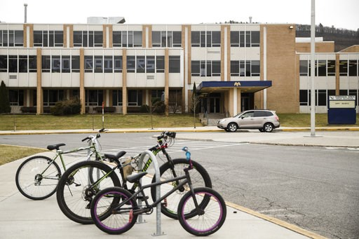 (AP Photo/Matt Rourke). Bicycles are parked outside Tamaqua Area High School in Tamaqua, Pa., Friday, Jan. 4, 2019. Parents are going to court to block the Tamaqua Area School District from allowing teachers to carry guns in school.